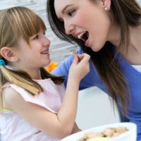 Girl and Woman in Responsive Feeding Session